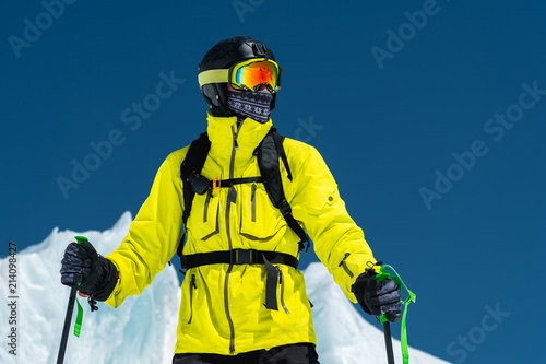 Canvas Print Skier standing on a slope