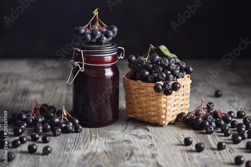 Aronia jam next to fresh berries
