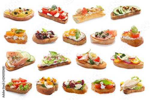 Fototapeta Set with different delicious bruschettas on white background