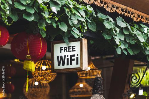 Fotografija Free Wi-Fi sign hanging in traditional chinese street restaurant