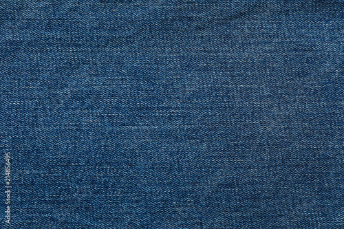 Canvas Print Texture of blue jeans as background