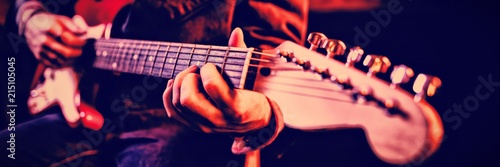 Fototapeta Mid-section of man playing guitar