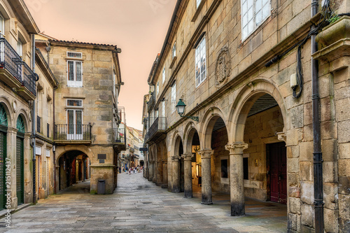 Canvas Print View of Santiago de Compostela old town street and buildings at sunset