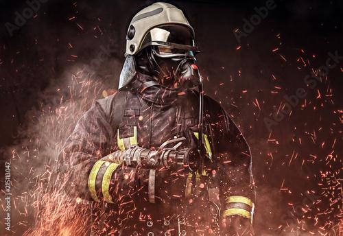 Canvas-taulu A firefighter dressed in a uniform in a studio.