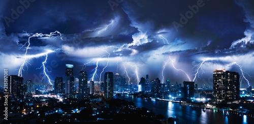 Lightning storm over city in blue light Fototapeta