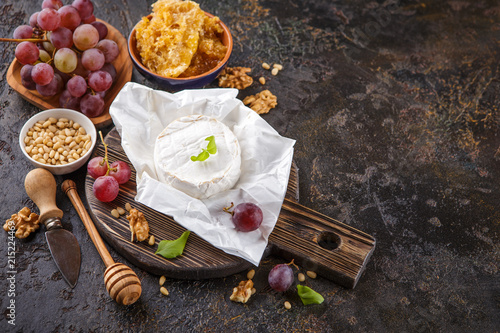 Cheese with honey, nuts and grapes