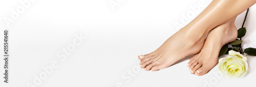 Beautiful bare Feet. Nail Varnishing, French Manicure in white color. Pedicure, Nails Polish in Beauty Salon Concept