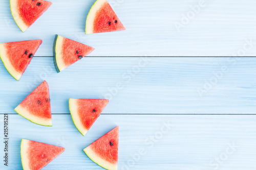 Watermelon slice on blue wood background,Concept food for summer,Top view and copy space