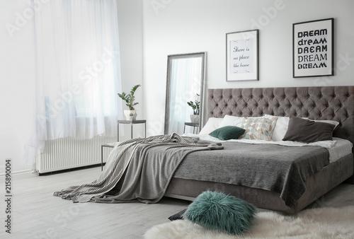 Fényképezés Elegant room interior with large comfortable bed
