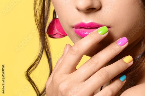 Slika na platnu Beautiful young woman with professional manicure on color background, closeup