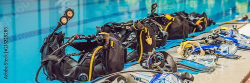 Obraz na płótnie Equipment for diving is on the edge of the pool, ready for a lesson BANNER, long