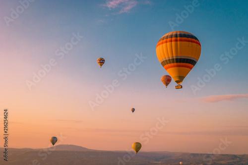 Fotografia hot air balloons during snrise Cappadocia Kapadokya Turkey, Fairytale landscape