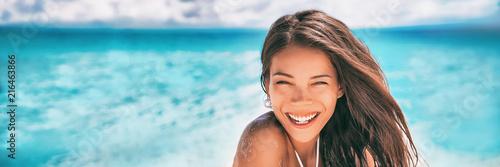 Beautiful Asian woman smiling relaxing on summer beach sunbathing banner panorama.