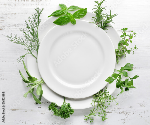 Empty plate with herbs