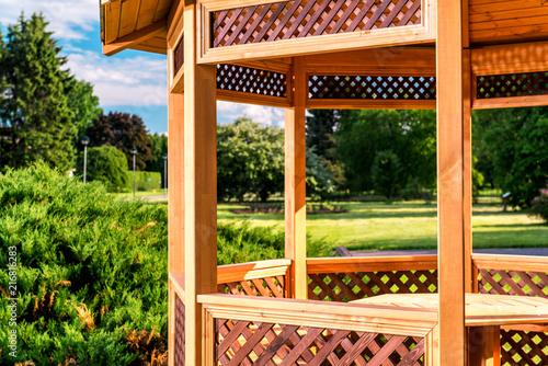 Outdoors wooden gazebo over summer landscape Fototapete