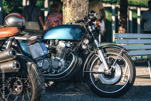 two classic style cafe racer motorcycle at sunset time Fototapeta
