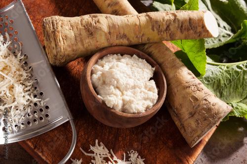 Raw horseradish roots and grated horseradish. Fototapet