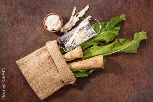 Roots and grated horseradish in burlap bag.