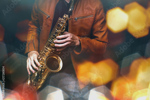 Jazz saxophone player in performance on the stage Fototapeta