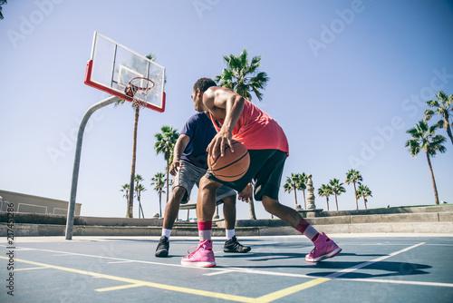 Friends playing basketball