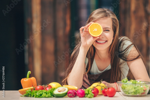 Happy young girl with an orange