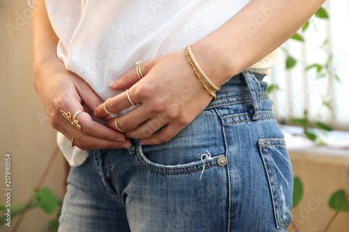 Close up of beautiful woman wearing shiny jewelry Fototapeta
