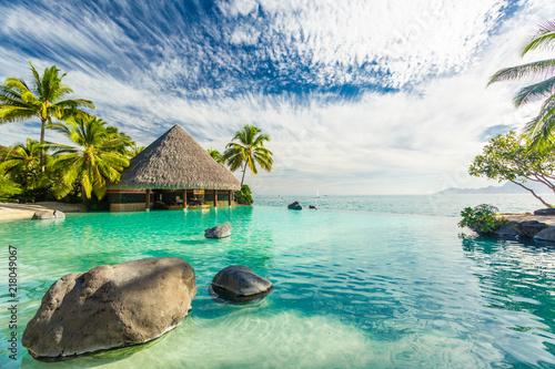 Fototapeta Infinity pool with palm tree rocks, Tahiti, French Polynesia