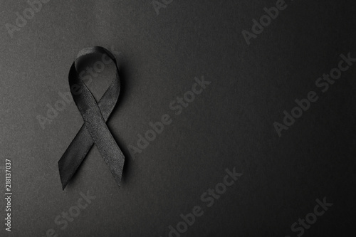 Fotografia Black ribbon and space for text on dark background, top view