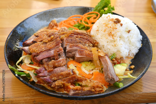Roasted duck with vegetables and rice, asian style