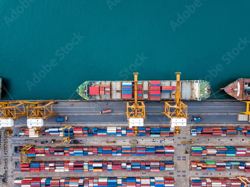 Stampa su Tela Top view of international port with Crane loading containers in import export business logistics