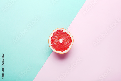 Ripe grapefruit slice on colorful background