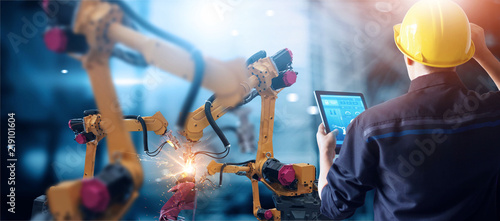 Stampa su Tela Engineer check and control welding robotics automatic arms machine in intelligent factory automotive industrial with monitoring system software