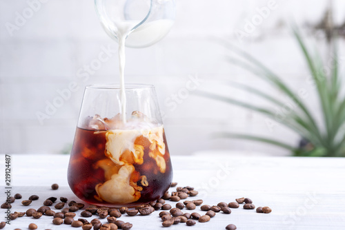 cold brew coffee with milk on white wooden table Fototapete