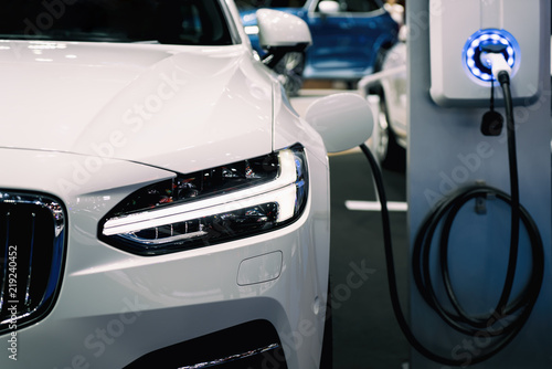 Power supply for hybrid electric car charging battery. Eco car concept.
