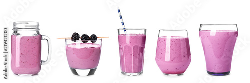 Set with blackberry smoothie on white background