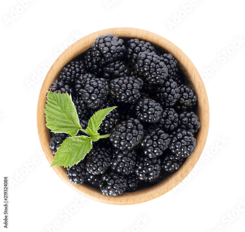 Bowl with ripe blackberries on white background, top view