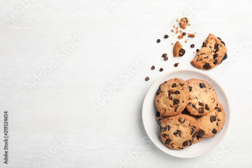 Flat lay composition with chocolate cookies and space for text on light background