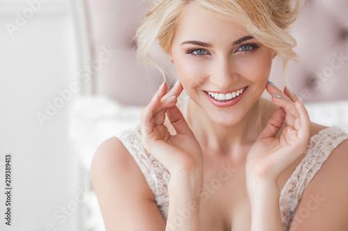 Slika na platnu Close up portrait of young beautiful woman indoors