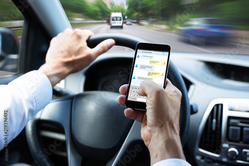 Canvastavla Man Typing Text Message On Mobile Phone While Driving Car
