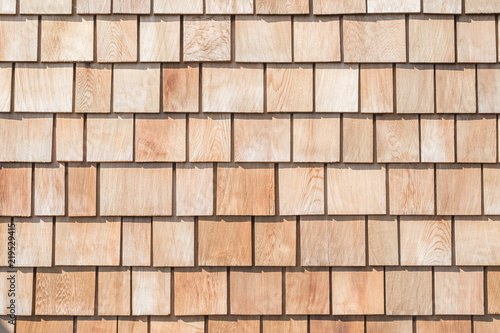 Fototapeta Shingle red cedar wooden shake wood siding row roof panel made of larch conifer