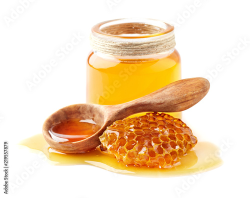 Wallpaper Mural Honey with honeycomb and wooden spoon