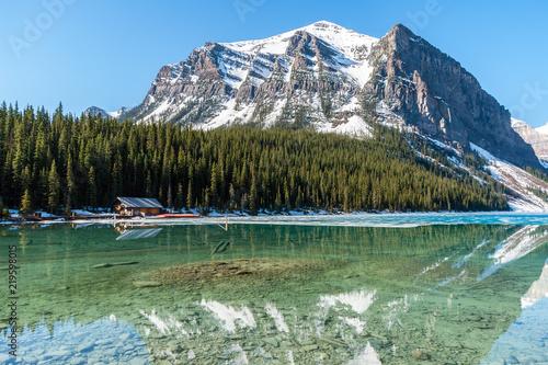 Boathouse next to half frozen lake Louise - Banff , Alberta, Canada Fototapete