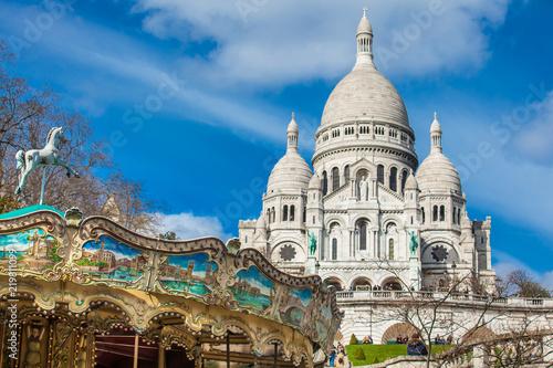 Canvas Print PARIS, FRANCE - MARCH, 2018: Carrousel and the Sacre Coeur Basilica at the Montm