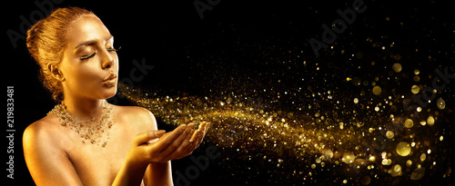 Gold Makeup - Fashion Model Blowing Golden Dust