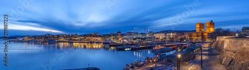 Photo Oslo panorama night city skyline at Oslo City Hall and Harbour, Oslo Norway