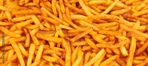 Crispy golden French fries background