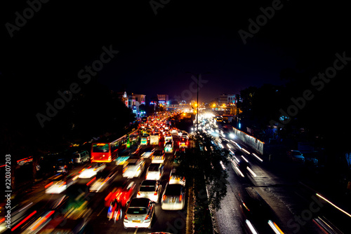 Heavy car traffic in the city center of Delhi, India at night