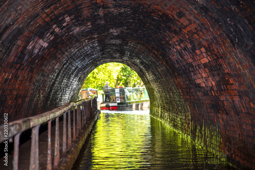 The Chirk Tunnel, built in the 18th century, is a still naviagable tunnel on the LLangollen Canal in Wales. Focus on tunnel.