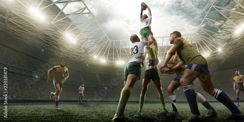 Photo Rugby players fight for the ball on professional rugby stadium