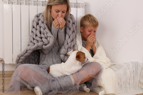 Cold home, freezing family, mother and son, Wrapped In Blanket Sitting Near Heat Fototapeta
